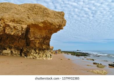 Albufeira, Algarve / Portugal - April 14 2019: Gale Beach and sandstone cliffs in Albufeira