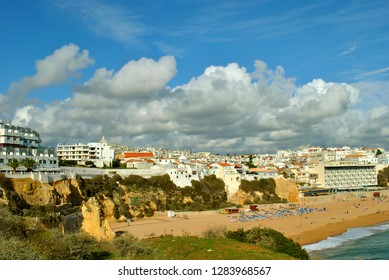 Albufeira, Algarve, Portugal - January 11, 2009 : People enjoying the sun on Albufeira Beach in Portugal