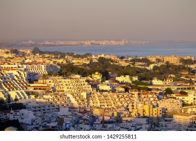 ALBUFEIRA, ALGARVE, PORTUGAL - MAI 26, 2019:  Aerial view on Albufeira on the sunset. Vacation in Portugal.