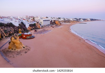 ALBUFEIRA, ALGARVE, PORTUGAL - MAI 26, 2019:  Aerial view on the beach Albufeira on the sunset. Vacation in Porugal.
