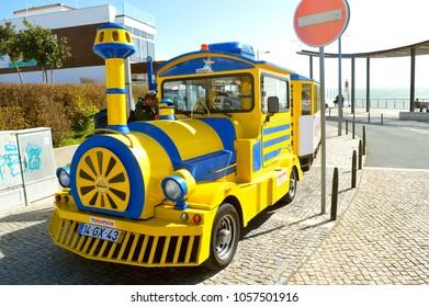 Albufeira, Algarve, Portugal - March 11, 2018 : Tourist train in Albufeira old town, Portugal