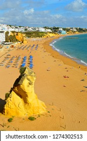 Albufeira, Algarve, Portugal - October 26, 2015 : Tourists enjoying the sun on Albufeira Beach in Portugal