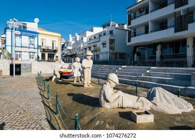 Albufeira, Portugal - April 16: A fisherman family statue in Albufeira, Algarve, Portugal.