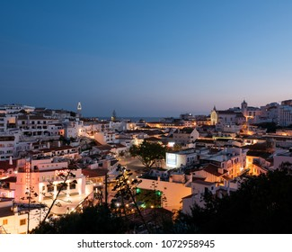 Albufeira, Portugal - April 16: Panoramic, night view of the Old Town of Albufeira City in Algarve, Portugal. Albufeira is a coastal city in the southern Algarve region of Portugal.