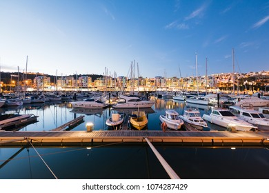 Albufeira, Portugal - April 17: General view of the Albufeira Marina at Night in Albufeira, Algarve, Portugal.