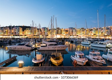 Albufeira, Portugal - April 17: Night view of Luxury yachts and motorboats at the Albufeira Marina at Night. Albufeira is a coastal city in the southern Algarve region of Portugal.