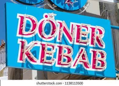 ALBUFEIRA, PORTUGAL - JULY 13TH 2018: A sign for a Doner Kebab takeaway shop in Europe, on 13th July 2018.
