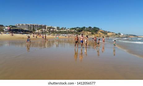 ALBUFEIRA, PORTUGAL - JULY 3, 2017: Beach in Albufeira, Portugal. Summer vacation season concept.