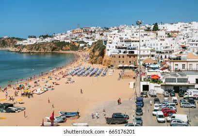 ALBUFEIRA, PORTUGAL - JULY 6, 2006: view of urban beach Praia do Peneco in Albufeira city. Albufeira is seaside resort in district of Faro, in the southernmost Portuguese region of Algarve