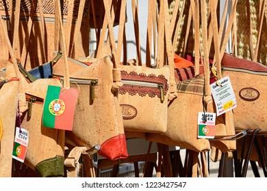 ALBUFEIRA, PORTUGAL - JUNE 10, 2017 - Traditional Portuguese cork handbags for sale in the old town, Albufeira, Algarve, Portugal, Europe, June 10, 2017.