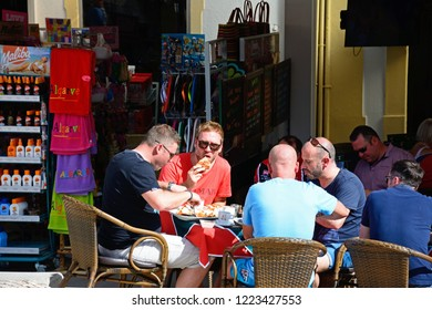 ALBUFEIRA, PORTUGAL - JUNE 10, 2017 - Tourists having breakfast at a pavement cafe in the old town, Albufeira, Algarve, Portugal, Europe, June 10, 2017.