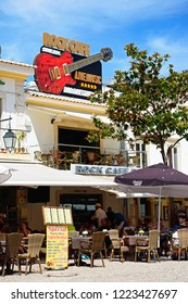 ALBUFEIRA, PORTUGAL - JUNE 10, 2017 - Tourists relaxing at the Rock Cafe in the main square in the old town during the morning, Albufeira, Algarve, Portugal, Europe, June 10, 2017.
