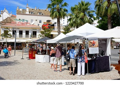 ALBUFEIRA, PORTUGAL - JUNE 10, 2017 - Tourist gift stalls in the main square of the old town, Albufeira, Algarve, Portugal, Europe, June 10, 2017.