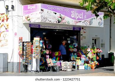 ALBUFEIRA, PORTUGAL - JUNE 10, 2017 - Traditional Portuguese tourist gift shop along Av 25 de Abril in the old town, Albufeira, Algarve, Portugal, Europe, June 10, 2017.