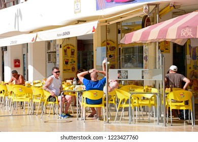 ALBUFEIRA, PORTUGAL - JUNE 10, 2017 - Tourists relaxing at a pavement cafe along Av 25 de Abril in the old town, Albufeira, Algarve, Portugal, Europe, June 10, 2017.