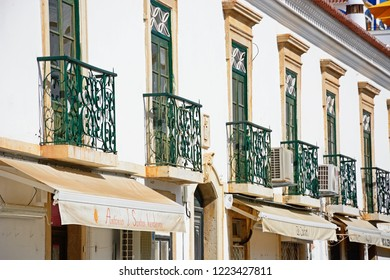 ALBUFEIRA, PORTUGAL - JUNE 10, 2017 - Traditional Portuguese buildings with wrought iron balconies in the old town, Albufeira, Algarve, Portugal, Europe, June 10, 2017.