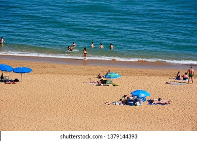 ALBUFEIRA, PORTUGAL - JUNE 6, 2017 -  Elevated view of the beach with tourists enjoying the setting, Albufeira, Algarve, Portugal, Europe, June 6, 2017.