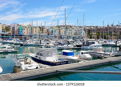 ALBUFEIRA, PORTUGAL - JUNE 8, 2017 -  Yachts and boats moored in the marina with apartments and waterfront businesses to the rear, Albufeira, Algarve, Portugal, Europe, June 8, 2017