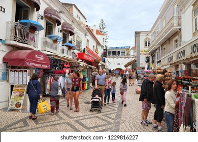 ALBUFEIRA, PORTUGAL - MAY 30, 2018: People visit downtown Albufeira, Portugal. The town is a popular tourism destination and has significant expat population.