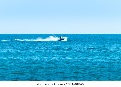 Albufeira, Portugal - September 09, 2016: Person riding a Jet boat Jet ski by the coasts of Albufeira, Algarve Portugal.
