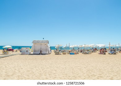 Albufeira, Portugal - September 09, 2016: Massage tent and sunbeds on the Albufeira beach, Algarve, Portugal