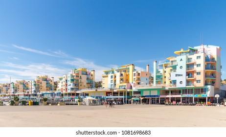 Albufeira, Portugal - September 10, 2016: Vivid view of buildings and boats in the bay Porto de Abrigo de Albufeira, Albufeira Bay.