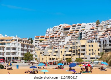 ALBUFEIRA, PORTUGAL - SEPTEMBER 11, 2017: People sunbathing and relaxing on the Fisherman's Beach (Praia dos Pescadores)