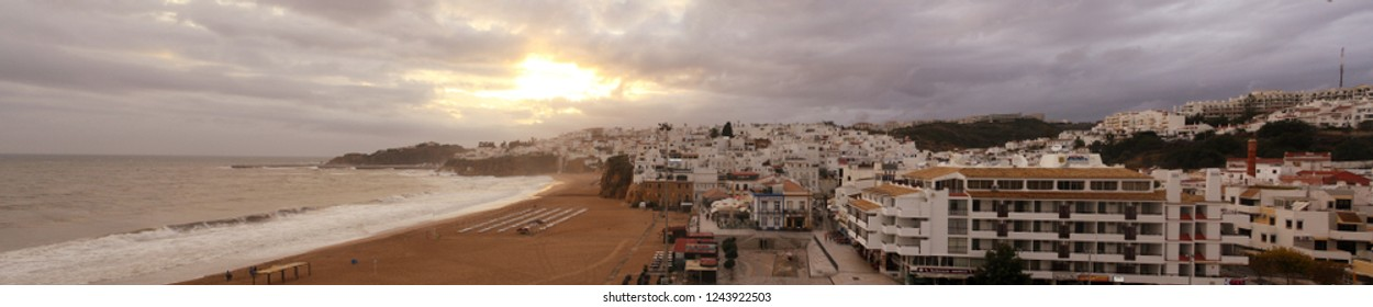 Albufeira/Portugal; 10/20/2015. Sunset in the beach of Albufeira, Algarve, Portugal. Panoramic View.