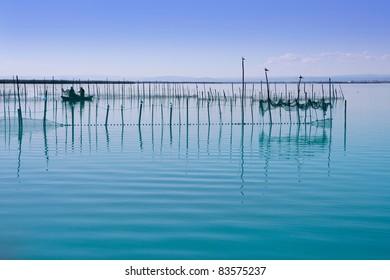 Albufera lake from Valencia Spain wetlands in mediterranean with fishermen tackle