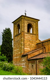 ALBUGNANO, PIEDMONT, ITALY - May 25, 2014 : View of the bell tower of the Abbazia of Santa Maria of Vezzolano, one of the most important medieval buildings in Piedmont, in Gothic-Romanesque style.