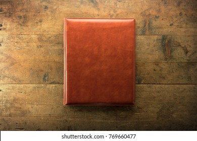 Album, Portfolio , Reservation book,  Visitors book on rustic old wood table.