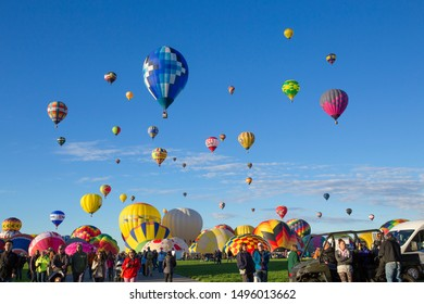 ALBUQUERQUE, NEW MEXICO - OCTOBER 1, 2016: Hot Air Balloon Festival in Albuquerque. Photo taken during a cold October morning when there are hundreds of balloons ascending shortly after dawn.