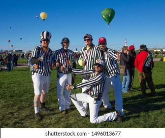 "ALBUQUERQUE, NEW MEXICO - OCTOBER 2, 2016: Hot Air Balloon Festival in Albuquerque. Launch directors, also known as ""zebras"" because of their black-and-white-striped outfits, serve as ""traffic cops,"""