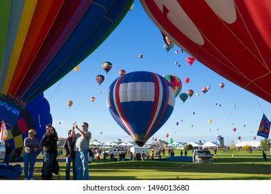 ALBUQUERQUE, NEW MEXICO - OCTOBER 2, 2016: Hot Air Balloon Festival in Albuquerque. Photo taken during a cold October morning when there are hundreds of balloons ascending shortly after dawn.