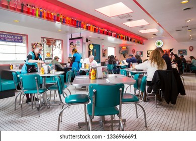 Albuquerque, New Mexico, USA, February 17, 2019 - Patrons and waitresses in Googie or Doo-Wop style 66 Diner on route 66