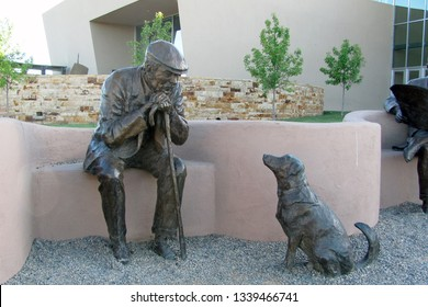 ALBUQUERQUE, NEW MEXICO, USA - May 21, 2014: Albuquerque Art Museum Sculpture Garden: Bronze sculpture, name: Park Place. Part of multi-piece sculptures done by artist Glenna Goodacre.