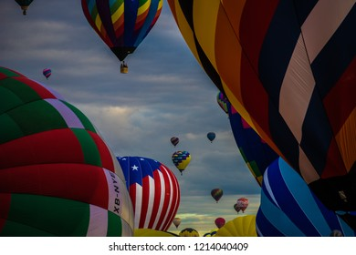 Albuquerque, New Mexico / USA - October 13, 2018: Ground view of colorful hot air balloons before and after mass ascension at the Albuquerque Balloon Fiesta