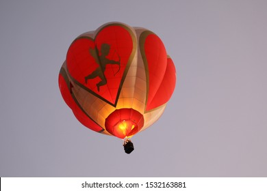 Albuquerque, New Mexico/ USA-October 6, 2019: Cupids Heart, the Hot Air Balloon, floating in the sky at the Albuquerque International Balloon Fiesta