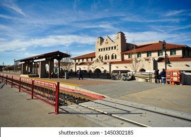 ALBUQUERQUE, NM / USA - DECEMBER 12 2010: The tracks, platform and Alvarado building at the Amtrak Station at Alvarado Transportation Center (ATC) on 1st Street SW in downtown Albuquerque