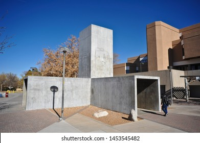 """ALBUQUERQUE, NM / USA - DECEMBER 13 2010: Poured concrete """"Center Of The Universe"""" by artist Bruce Nauman, on Yale Mall on UNM campus, shows x-y-z axes of a Cartesian coordinate sys"""