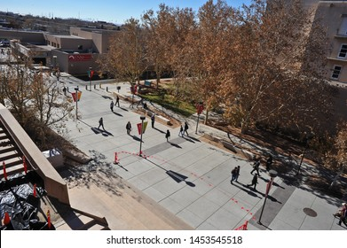 ALBUQUERQUE, NM / USA - DECEMBER 13 2010: Students rush to and from class at Redondo Dr and Cornell Mall on University of New Mexico campus, Albuquerque, from the top of the parking structure.