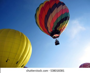 Albuquerque, NM, USA - October 2, 2011: Colorful hot air balloon rising at dramatic angle during Balloon Fiesta 2011.