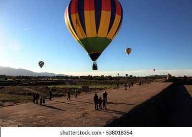 Albuquerque, NM, USA - October 7, 2016: People watching as hot air balloons land in Domingo Baca Park during Balloon Fiesta 2016.