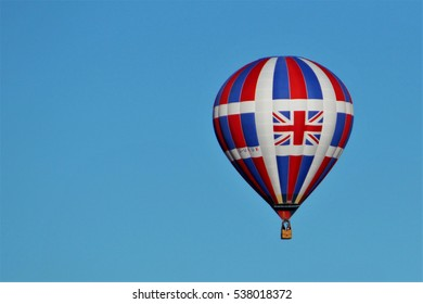 Albuquerque, NM, USA - October 7, 2016: Hot air balloon with Union Jack soars against pale blue sky during Balloon Fiesta 2016.