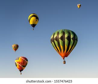 ALBUQUERQUE, NM/USA - OCTOBER 11, 2019: Five colorful, hot air balloons descending at the Albuquerque International Balloon Fiesta.