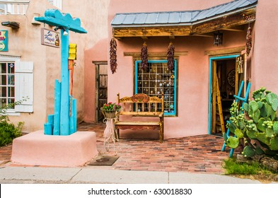 Albuquerque, USA - July 28, 2015: Old town plaza at hidden patio with San Pasquals shop and decorative sidewalk with brick paths, flowers, dried chiles, and gardens