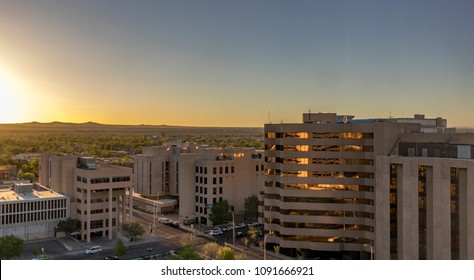 Albuquerque - view of downtown offices and the volcanoes of Petroglyph National Monument at sunset in springtime in Downtown Albuquerque, New Mexico, USA.