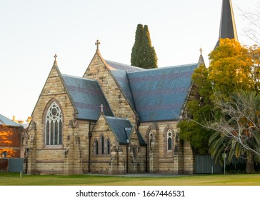 Albury, New South Wales, Australia - July 31 2019: Old Historical Building of St Matthew's Church with Textured Stone Walls and Arch window during a Cold Winter afternoon