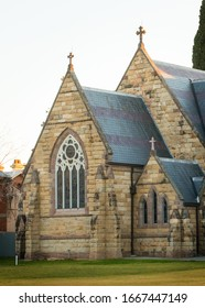 Albury, New South Wales, Australia - July 31 2019: Portrait of a historical building St Matthew's Church with textured stone walls and arch windows. Beautiful architecture of old buildings.