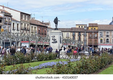 ALCALA DE HENARES, SPAIN - APRIL 23th 2016: People in Cervante's square, during 4th centenary of Miguel de Cervantes's death, in Alcala de Henares, on April 23th 2016. Iron sculpture from behind.
